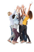Young people raising hands — Stock Photo