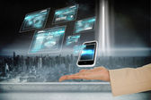 Hand presenting smartphone and interfaces — Stockfoto