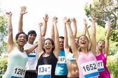 Marathon runners cheering in park — Stock Photo