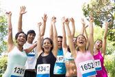 Marathon runners cheering in park — Stock Photo