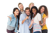 Happy group of friends having fun doing karaoke — Stock Photo
