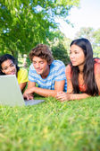 College students using laptop — Stock Photo