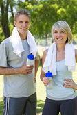 Happy couple after a workout in park — Stock Photo