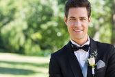 Confident groom in garden — Stock Photo