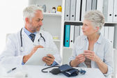 Senior woman visiting doctor — Stock Photo