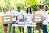Volunteers with donation boxes — Stock Photo