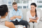 Couple with arms crossed at therapy session — Stock Photo