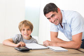 Father assisting son with homework — Stock Photo