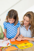 Mother and daughter coloring — Stok fotoğraf