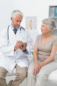 Female senior patient visiting a doctor — Stock Photo