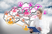 Businesswoman using tablet pc with cloud computing graphic — Stock Photo