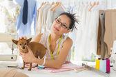 Female fashion designer and dog — Stok fotoğraf