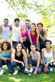 Friends in sportswear at park — Stock Photo