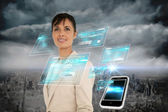Businesswoman with interface and smartphone — Stock Photo