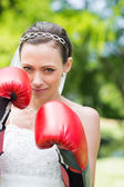 Woman in wedding dress with boxing gloves — Stock Photo
