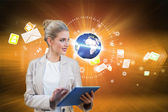 Businesswoman using tablet pc with earth and emails — Foto Stock