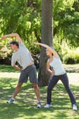Couple exercising in the park — Stock Photo
