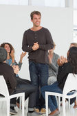 Rehab group applauding happy man standing up — Foto Stock