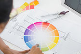 Interior designer looking at colour wheel — Stock Photo