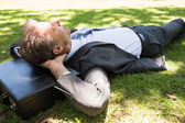Businessman resting in park — Stock Photo