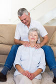 Man giving his relaxed senior wife a shoulder rub — Stock Photo
