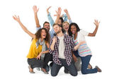 Smiling group of young friends having fun doing karaoke — Stock Photo