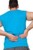 Rear view of man in sportswear suffering from backache — Stock Photo