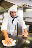 Cook wiping the counter top — Stock Photo