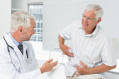 Male senior patient visiting a doctor — Stock Photo