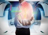 Businessman presenting medical interface — Stock Photo