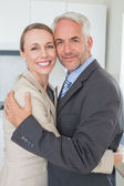 Happy business couple hugging each other before work in morning — Stock Photo