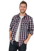 Man with hands in pockets — Stock Photo