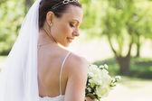 Bride with flowers in garden — Stock Photo