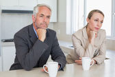 Bored business couple having coffee before work in morning — Stock Photo