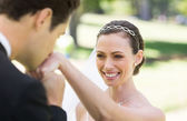 Groom kissing on hand of bride — Stock Photo