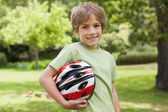 Boy with bicycle helmet — Stock Photo