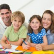 Parents with children drawing — Stockfoto #42931875