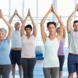 People with eyes closed and joined hands at fitness studio — Stock Photo #42932267