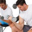 Two fit young men exercising with dumbbells — Stock Photo #42932273