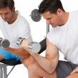 Two fit young men exercising with dumbbells — Stock Photo