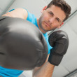 Determined male boxer focused on training — Stock Photo
