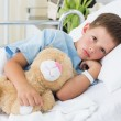 Boy with teddy bear in hospital — Stock Photo