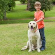 Boy with pet dog at park — Stock Photo #42933621