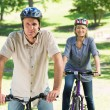 Couple bike riding in park — Stock Photo #42934403