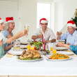 Family having Christmas meal — Stock Photo #42934511