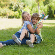 Kids with pinwheels — Stock Photo