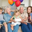 Family celebrating girls birthday — Stock Photo #42934797