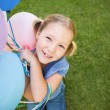 Portrait of a girl with colorful balloons at park — Stock Photo #42934927