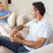 Relaxed couple sitting on sofa — Stock Photo #42934983