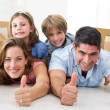 Family showing thumbs up — Stock Photo #42935067